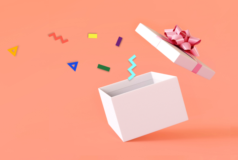 Box with confetti coming out on coral background